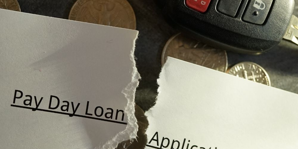 payday loan application torn with a car key
