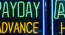 Payday loan neon sign. Predatory Lending.